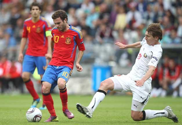 Spain's Juan Mata (left) gets the pass away against Belarus at the European Under-21 Championship