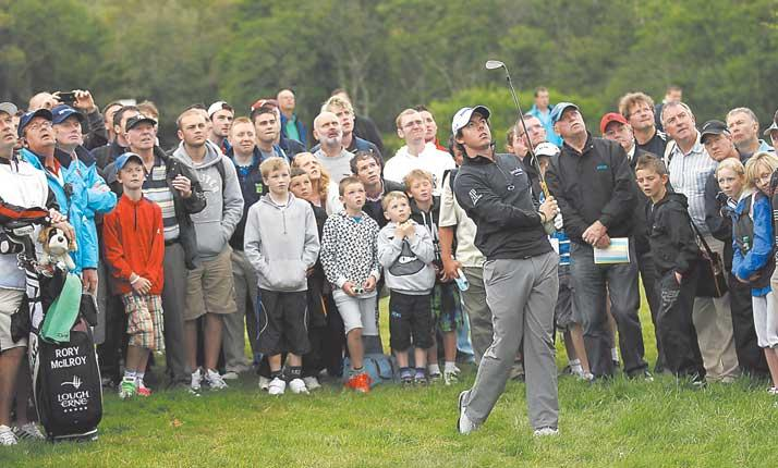 Rory McIlroy plays out of the rough during a one-under 70 which leaves him off the pace at the Irish Open