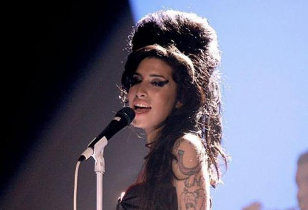 Amy Winehouse's surge in sales mirrors that of Michael Jackson and Johnny Cash