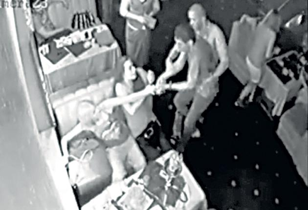 A man believed to be Roman Landik is seen on video allegedly beating Maria Korshunova in Luhansk's Bakkara restaurant on 4 July