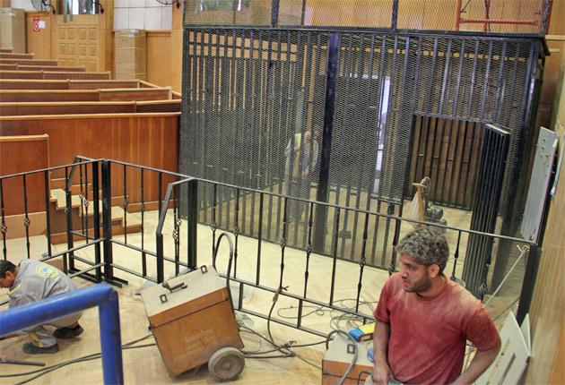 Workers prepare the courtroom for the trial of Hosni Mubarak