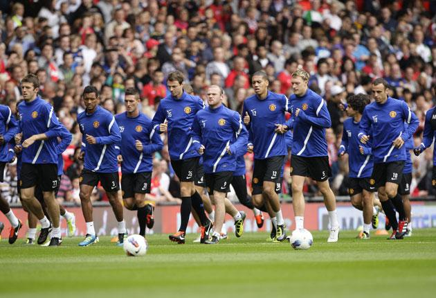 Manchester United hold an open training session in front of 12,000 fans at Old Trafford yesterday