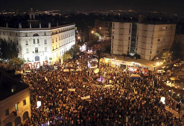 Israelis marching through Jerusalem at the weekend; 300,000 protested around the country