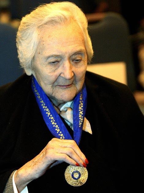 Nancy Wake displays her Companion in the General Division of the Order of Australia award she received in 2004