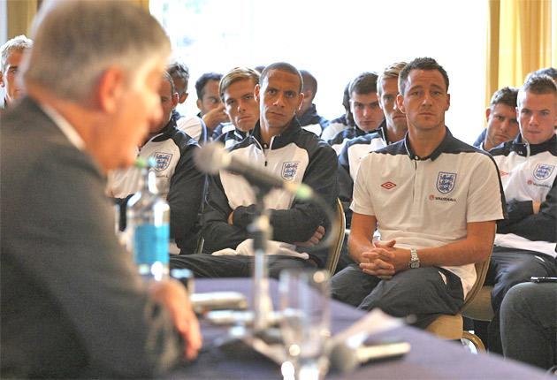 England players listen to David Bernstein yesterday as he addresses the media about the cancellation of tonight's friendly