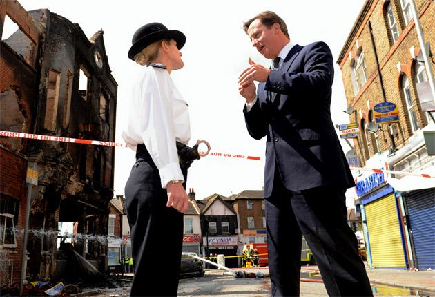 David Cameron meets Acting Borough Commander Superintendent Jo Oakley on a visit to Croydon