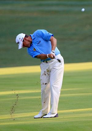 Lee Westwood hits an approach shot on the 10th hole during round two