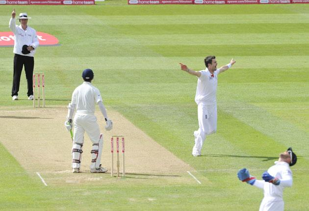 James Anderson celebrates after Matt Prior catches Rahul Dravid to give him his third wicket of the innings and draw level with Sir Alec Bedser on the all-time England list