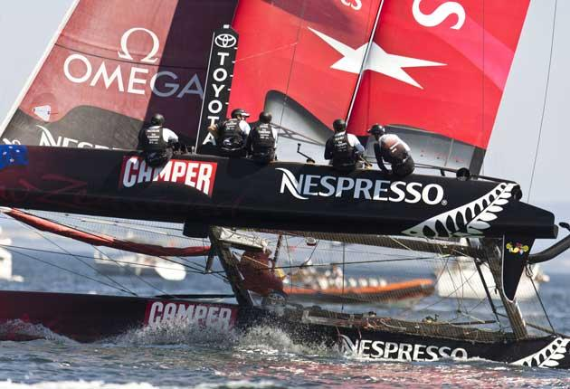 Flying high, Dean Barker's Emirates Team New Zealand on its way to winning the inaugural America's Cup World Series regatta in Cascais, Portugal