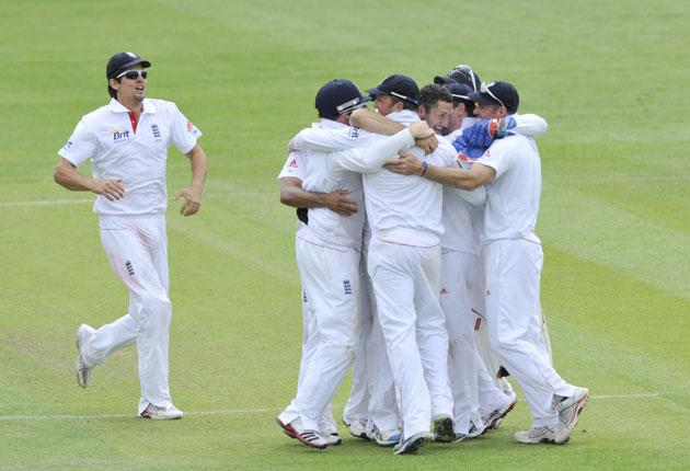 Tim Bresnan is hugged after taking the final wicket to confirm England's place at the top of the pile