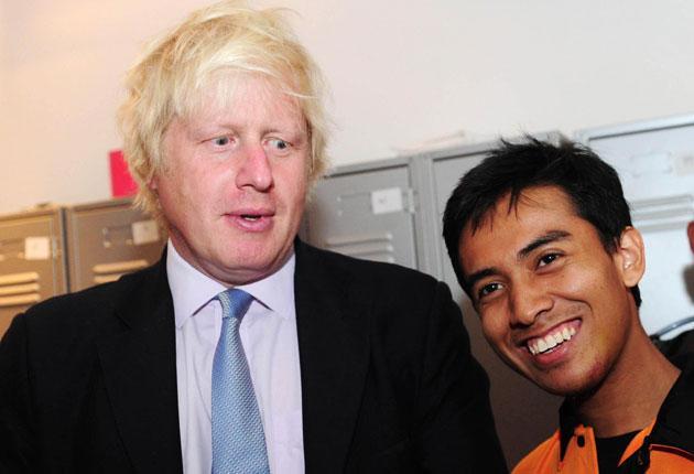 Boris Johnson with Ashraf Rossli who was mugged during the riots