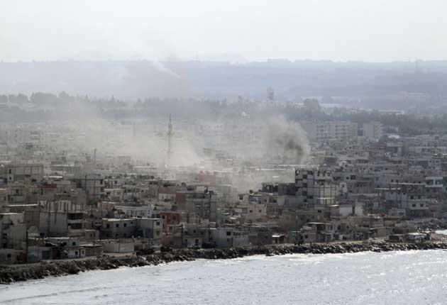Syrian tanks and navy ships shelled the main Mediterranean port city of Latakia yesterday
