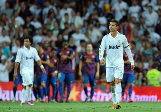 Ronaldo looks frustrated as Barcelona celebrate