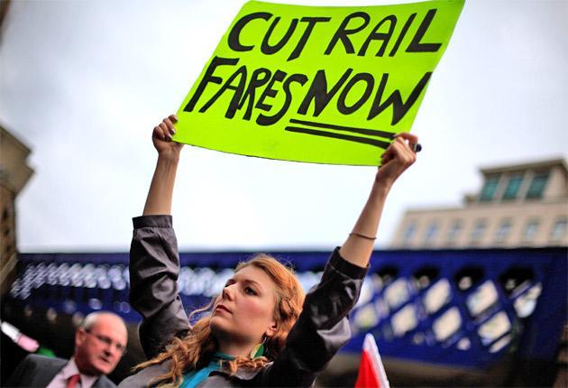 A demonstrator outside Waterloo Station in London yesterday