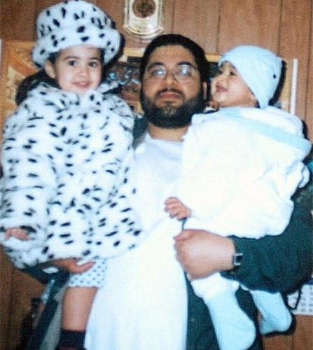 Shaker Aamer holding his daughter Johninh and his son Michael