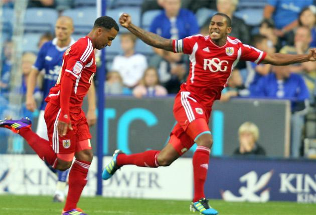 Bristol City's Nicky Maynard (left) celebrates scoring his first goal last night