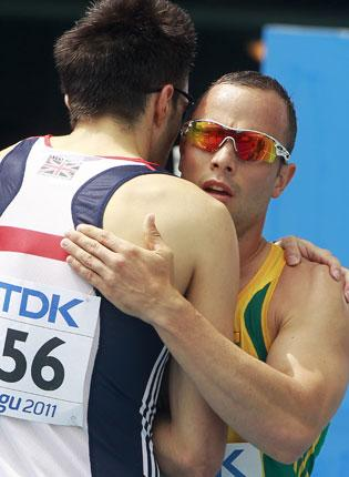 Martyn Rooney (left) and Oscar Pistorius