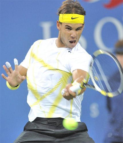 Spain's Rafael Nadal, sporting bandages on his burnt fingers, returns to Kazakhstan's Andrey Golubev at Flushing Meadows