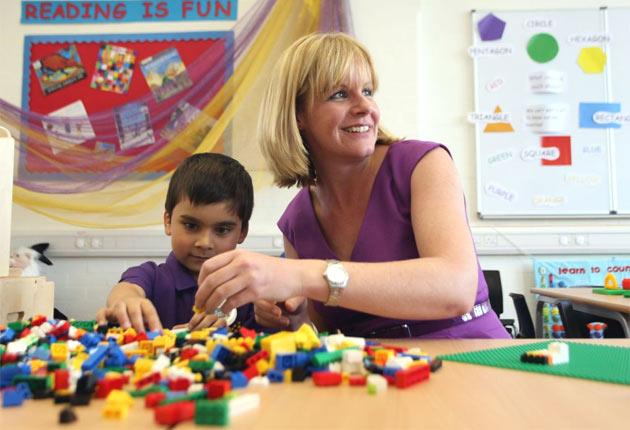Principal Nicola Perry with six-year old Areeb Azeem on the first day of Aldborough E-ACT Free School in Redbridge, east London