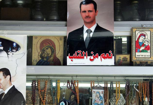 Portraits of President Bashar al-Assad at a shop selling Christian icons in Damascus