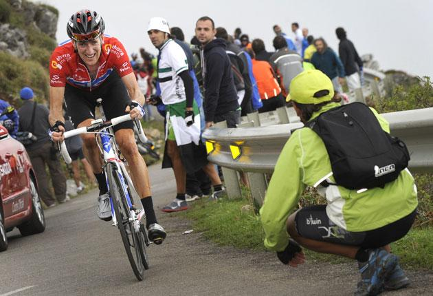 Bradley Wiggins climbs during yesterday's14th stage