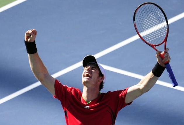 Andy Murray celebrates beating John Isner last night