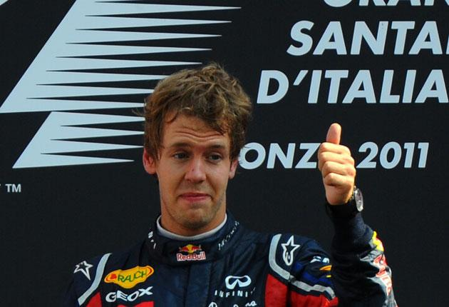 Sebastian Vettel was emotional on the podium after winning at Monza,  the scene of his first victory in 2008