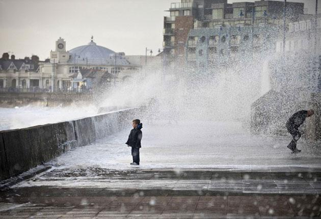 Stormy seas at Porthcawl: The Met Office said that winds of up to 80mph pounded the north and west but predicted the weather would calm down by mid-week.