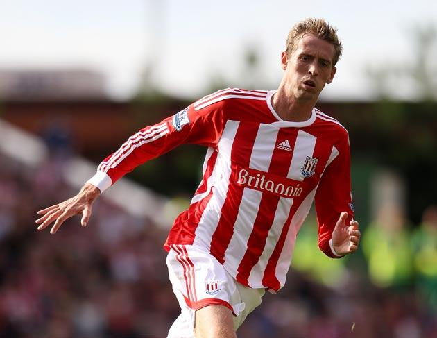 Peter Crouch rose above the Manchester United defence to equalise for Stoke yesterday