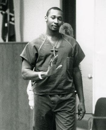 Troy Davis enters court for a hearing in 1991 while on trial for the shooting of an off-duty police officer
