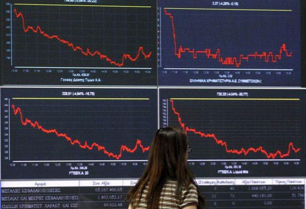 Screens showing stocks at the Athens Stock Exchange in Athens