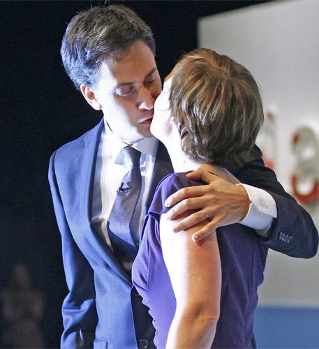Ed Miliband kisses his wife, Justine Thornton, after his conference speech