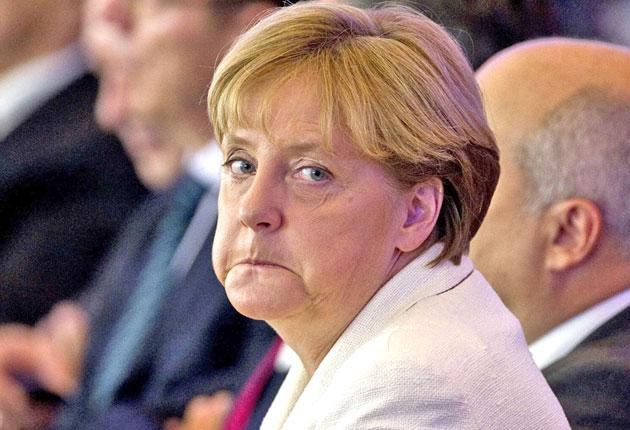 Angela Merkel is still struggling to persuade her   ruling coalition to vote in favour an extension of powers for the eurozone's financial rescue fund