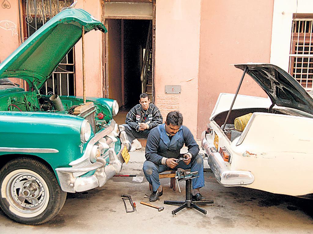American vintage cars being repaired