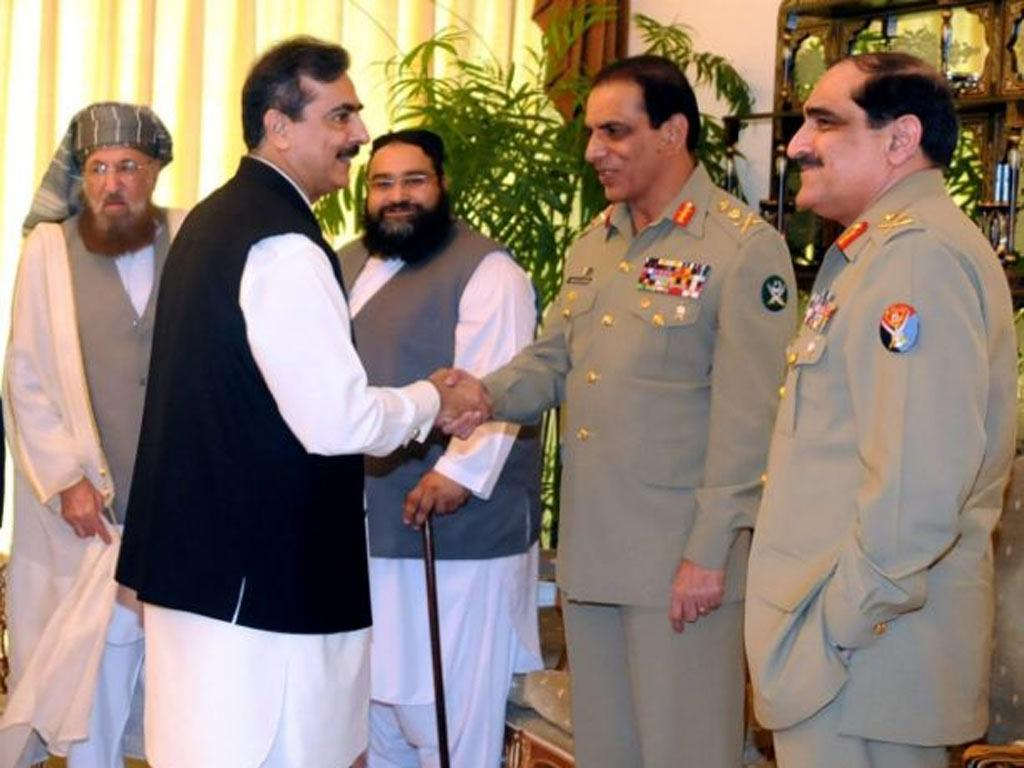 Pakistan's Prime Minister Yousuf Raza Gilani greets Army Chief General Ashfaq Pervez Kayani at the All Parties Conference in Islamabad