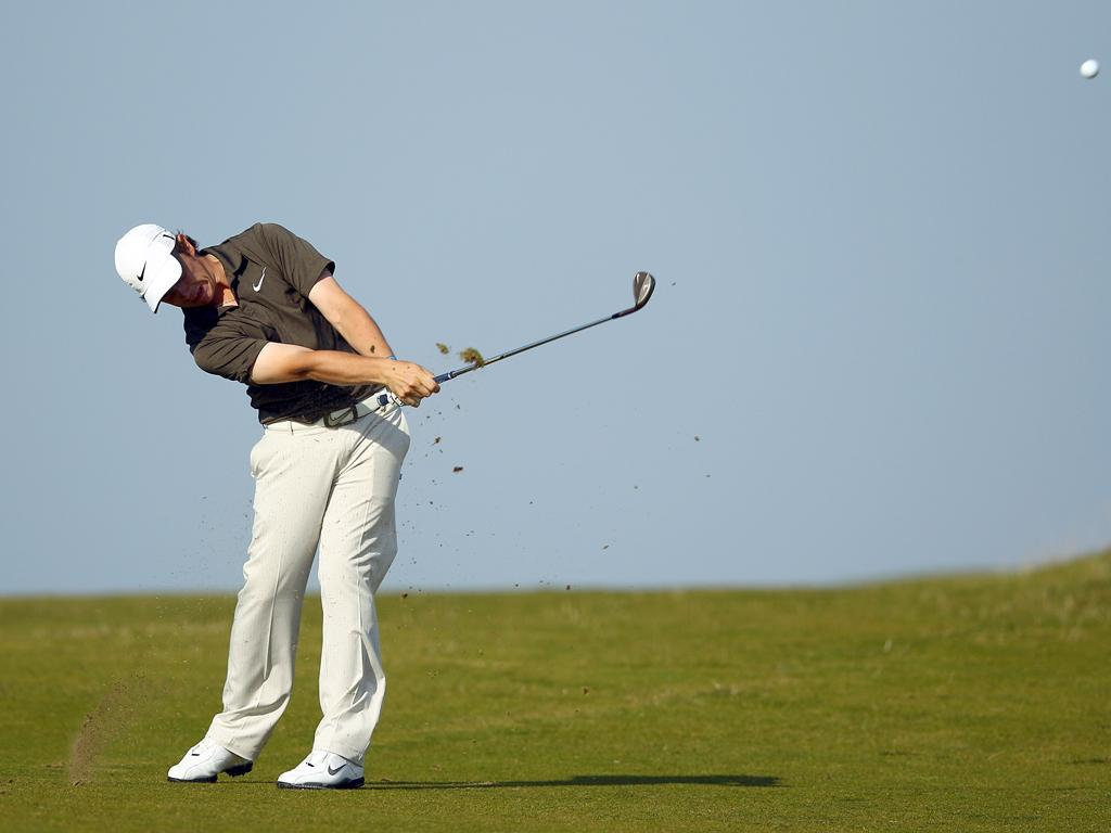 Tommy Fleetwood, another of England's young guns, plays his approach to the 18th hole