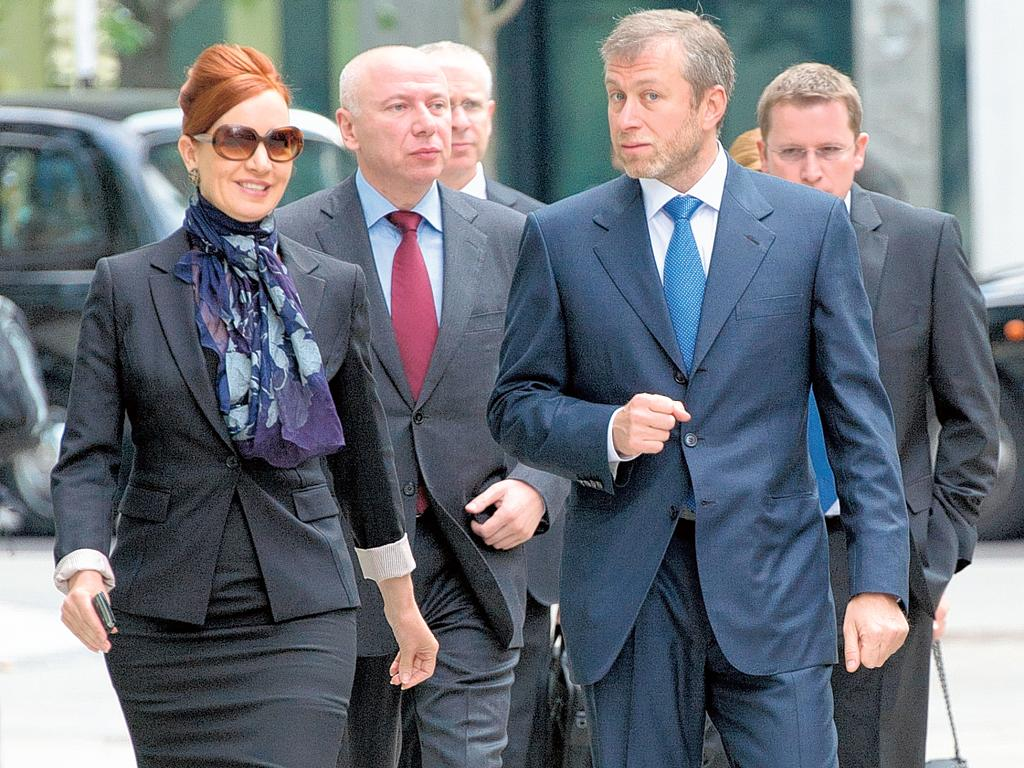 """Flanking Roman Abramovich as he strode into court yesterday were an intimidating set of corporate henchmen. Karyl Nairn, far left, heads the arbitration division at Skadden, one of London's """"fearsome four"""" law firms. Next to her, David Davidovich – a bill"""