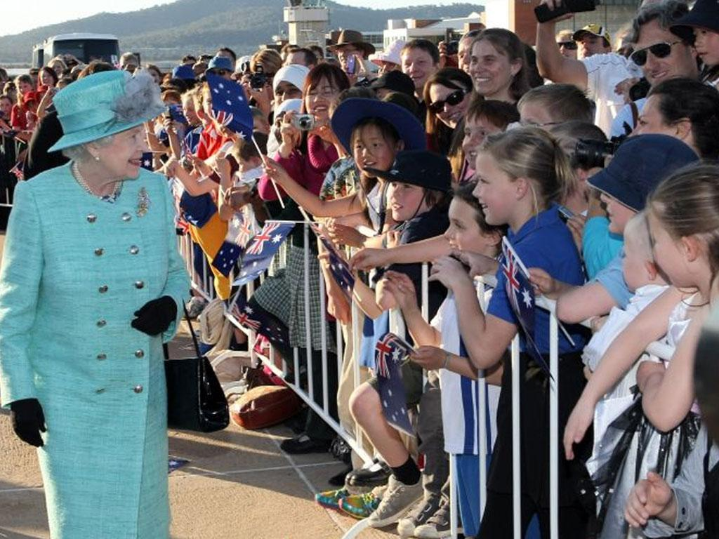 The Queen is greeted by well-wishers after arriving in Canberra for the start of her 10-day tour