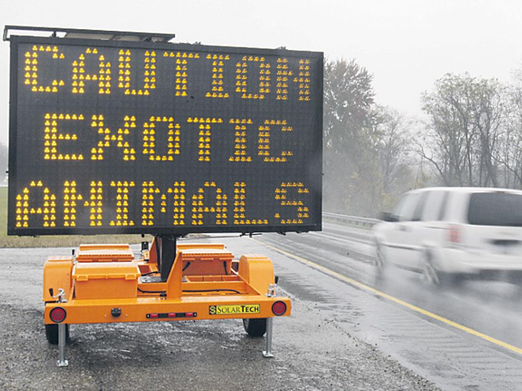 A sign warning motorists that exotic animals are on the loose