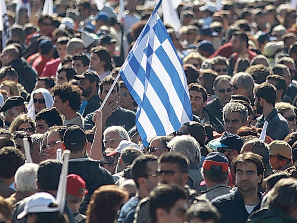 Protesters gather in Athens as the Greek parliament votes on fresh cuts