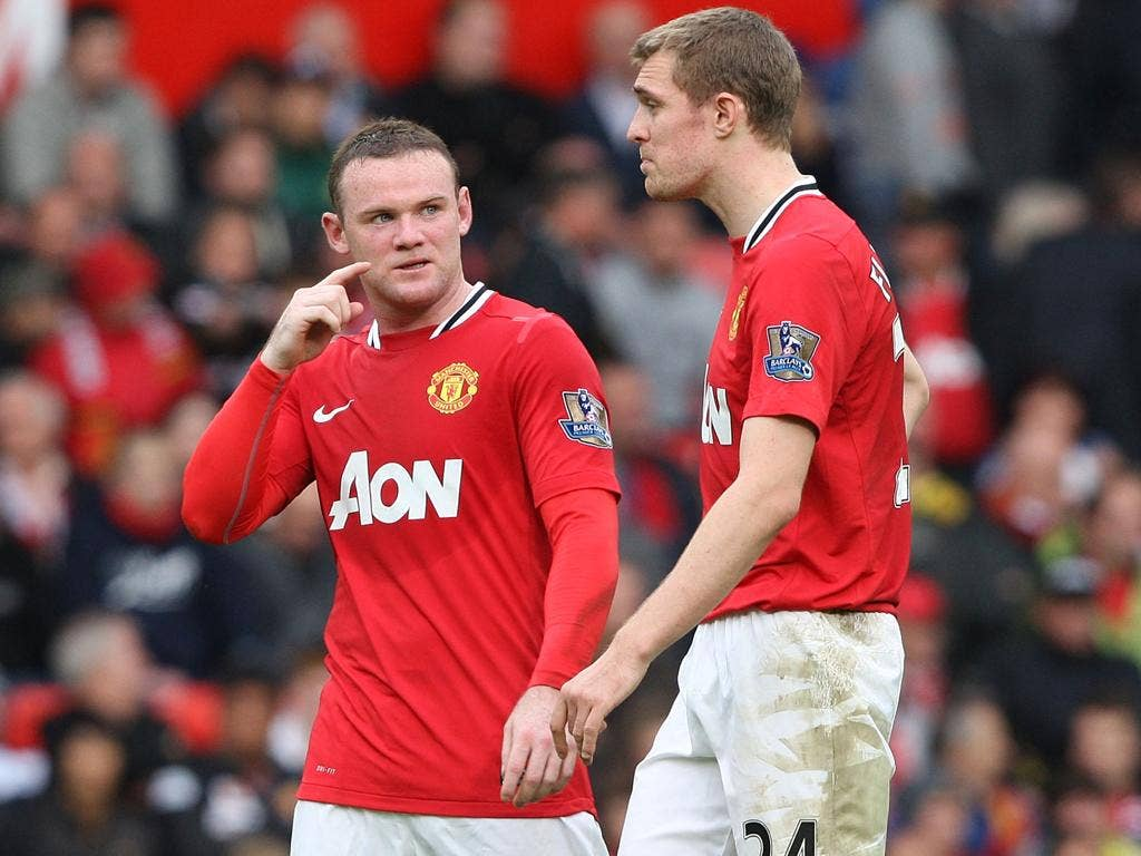 Darren Fletcher (right) and Wayne Rooney are left stunned by the 6-1 defeat to Manchester City