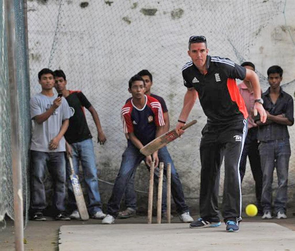 Kevin Pietersen entertains schoolchildren in Kolkata yesterday