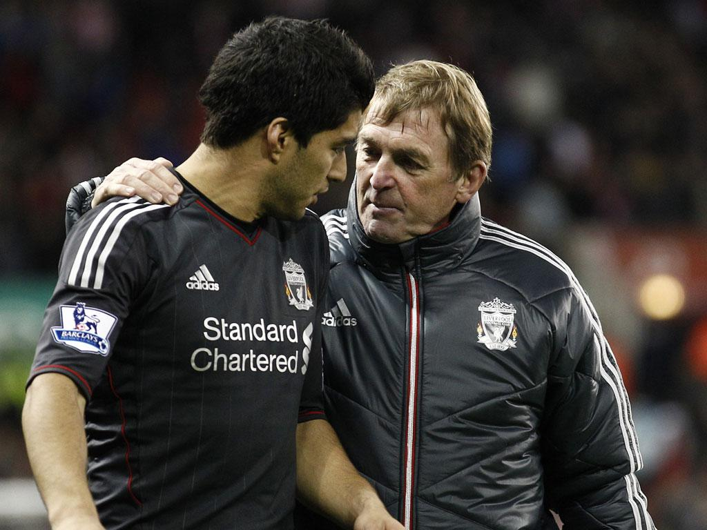 Kenny Dalglish has again leapt to the defence of striker Luis Suarez