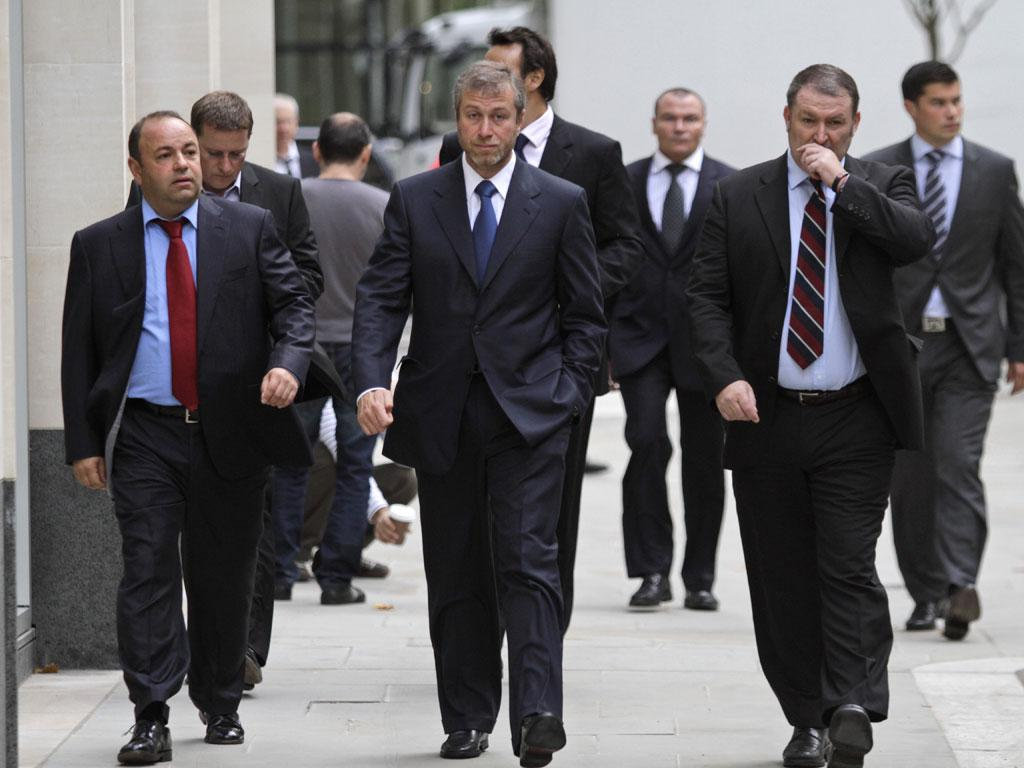 Roman Abramovich arriving at court with his minders