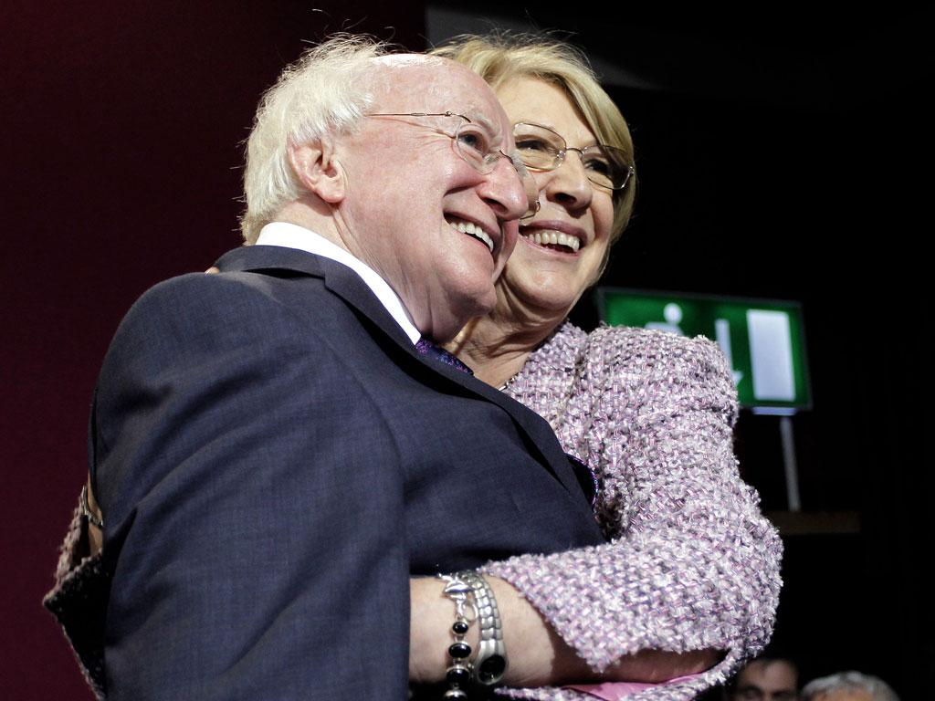 Michael D Higgins is congratulated by his wife, Sabina, after his victory