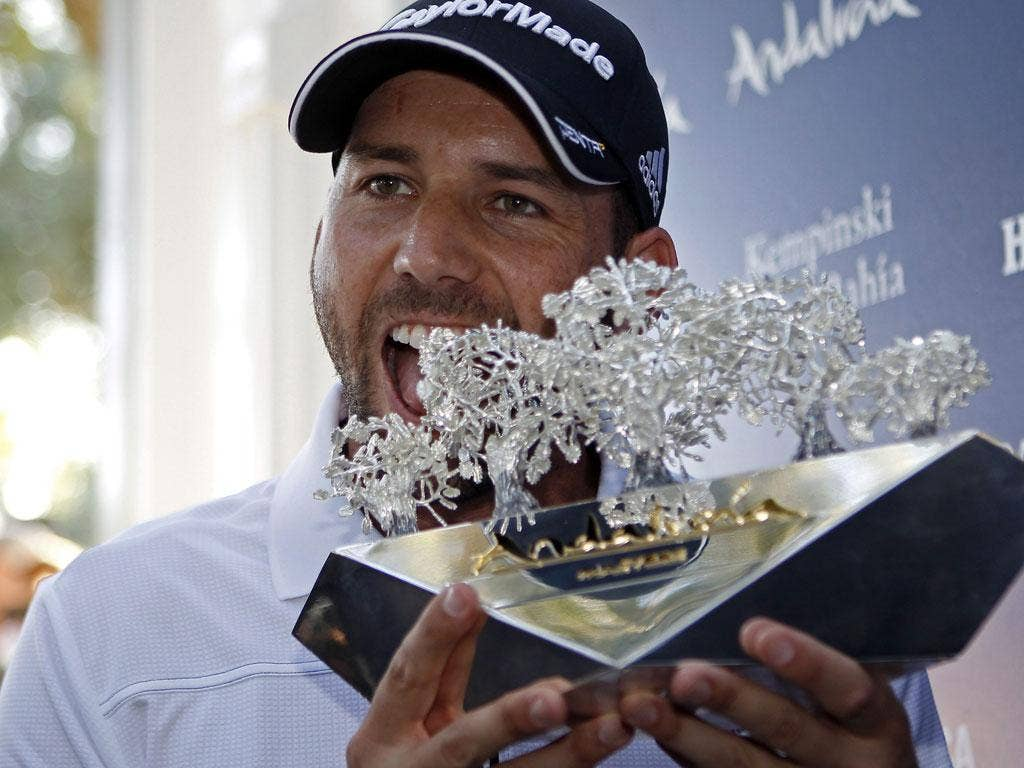Garcia celebrating with the winner's trophy after the fourth and last stage of the Andalucia Masters on Sunday
