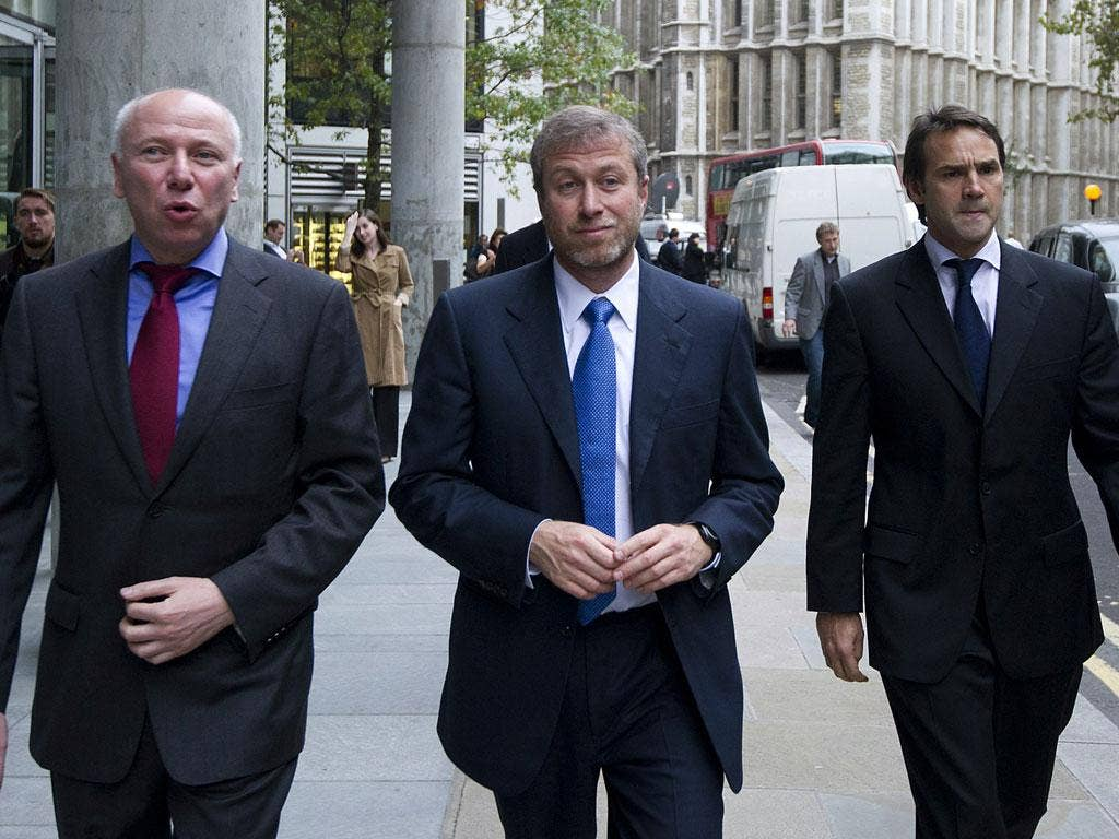 Roman Abramovich arrives at court yesterday with David Davidovich