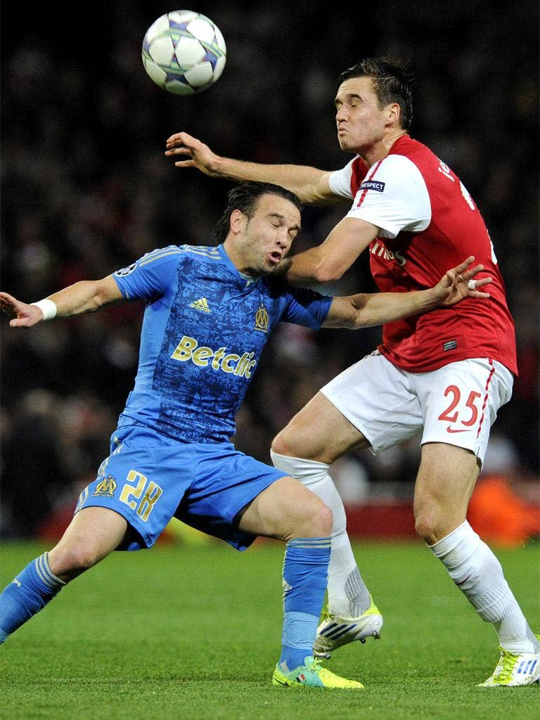 Arsenal's Carl Jenkinson, right, competes for the ball with Marseille's Mathieu Valbuena during an uneventful encounter at the Emirates
