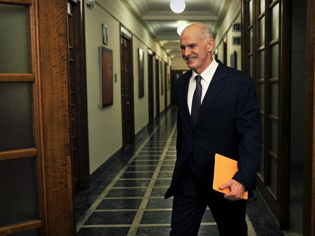 Greek Prime Minister George Papandreou arrives for a cabinet meeting at the greek parliament in Athens