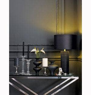 By varying the heights of these black candles, the look is informal yet sleek. All available at the new John Lewis candle shop.